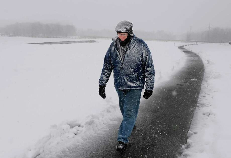 George Houck of Colonie takes the weather in stride as he takes his daily walk through The Crossings Tuesday March 13, 2018 in Colonie, NY.  (John Carl D'Annibale/Times Union) Photo: John Carl D'Annibale, Albany Times Union / 20043196A