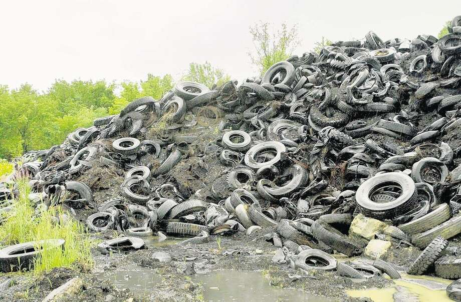 Used tires are piled high at Mohawk Tire Storage Facility in Waterford in this 2004 photograph. The state announced that all 7.1 million tires have now been removed from the site. ( Will Waldron / Times Union Archive) Photo: WILL WALDRON / ALBANY TIMES UNION