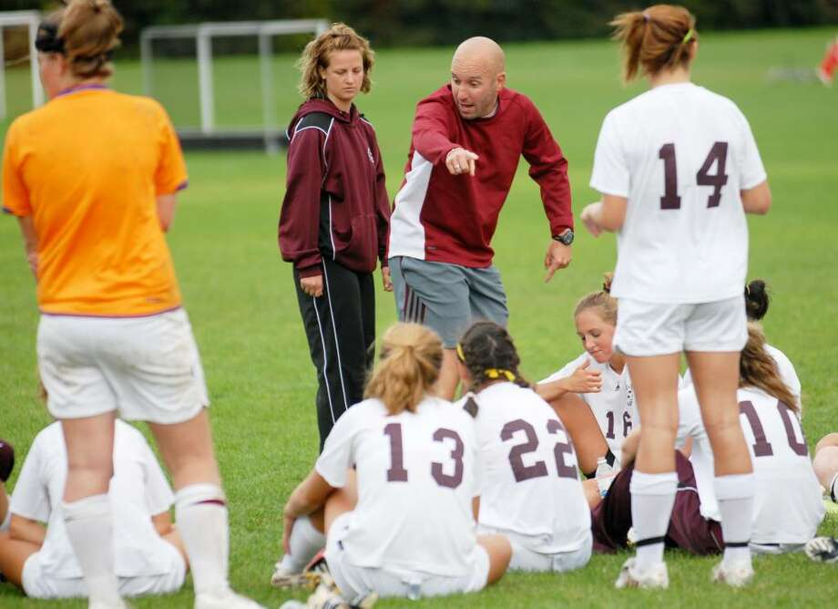 Brian Bold, coach of the Burnt Hills-Ballston Lake girls' soccer team, talks to his players Tuesday at their game against Shaker High School. Assistant coach Katie Sweet is at Bold's side. (Luanne M. Ferris / Times Union) Photo: LUANNE M. FERRIS / 00005728AA