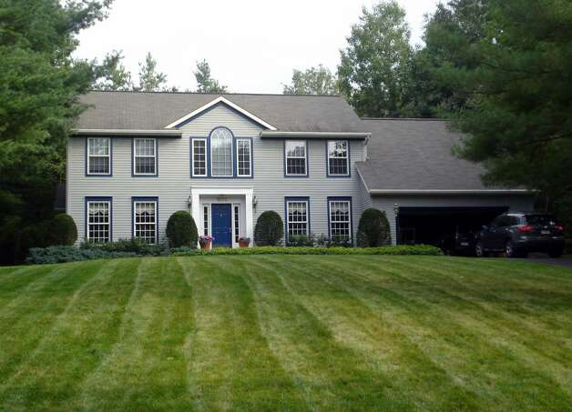 A 3,275-square-foot Colonial-style home with five bedrooms, two bathrooms and two half-bathrooms at 1054 Valerie Drive in Merlin Park is selling for $409,900. (Michael Lisi / Special to the Times Union)