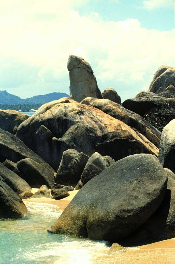 Grandfather Rock on the island of Koh Samui, Thailand, draws tourists because of its peculiar phallic shape. A recent incident of a tourist behaving badly at the rock has angered locals. Photo: Peter Bischoff/Getty Images