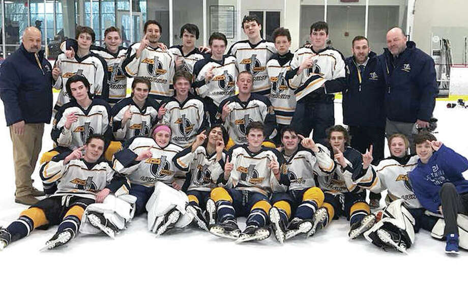 Players and coaches for the Twin Bridges Lightning under-16 team celebrate their victory over Chesterfield, Mo. in Sunday's final of the USA Hockey National Tourney qualifying tourney in Kirkwood. The under-16 Lightning will play at the nationals April 5-9 in Wayne, N.J. Photo: Submitted Photo
