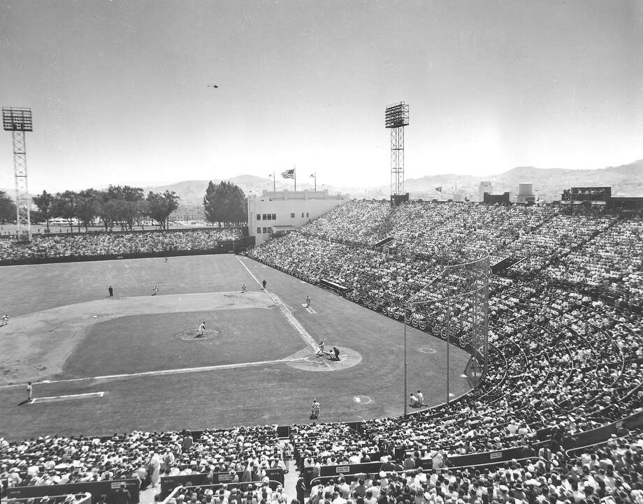 The San Francisco Giants play the Los Angeles Dodgers during opening game of the first Giants game at Seals Stadium in San Francisco, Ca., April 15, 1958. The Giants defeated the Dodgers, 8-0, and set an attendance record for the stadium with 23,192 fans. (AP Photo)  Ran on: 04-01-2007  Willie Mays, who had established himself as one of the game's best players, runs onto the field prior to the Giants' 1958 opener.  Ran on: 04-01-2007  Willie Mays, who had established himself as one of the game's best players, runs onto the field prior to the Giants' 1958 opener.  Ran on: 04-01-2007 Photo: Associated Press 1958