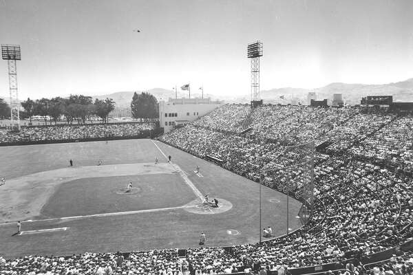 The San Francisco Giants play the Los Angeles Dodgers during opening game of the first Giants game at Seals Stadium in San Francisco, Ca., April 15, 1958. The Giants defeated the Dodgers, 8-0, and set an attendance record for the stadium with 23,192 fans. (AP Photo)  Ran on: 04-01-2007  Willie Mays, who had established himself as one of the game's best players, runs onto the field prior to the Giants' 1958 opener.  Ran on: 04-01-2007  Willie Mays, who had established himself as one of the game's best players, runs onto the field prior to the Giants' 1958 opener.  Ran on: 04-01-2007