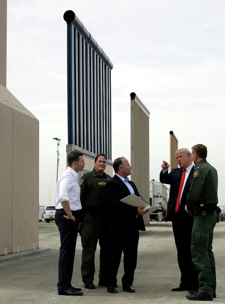 President Donald Trump revieww border wall prototypes, Tuesday, March 13, 2018, in San Diego,.