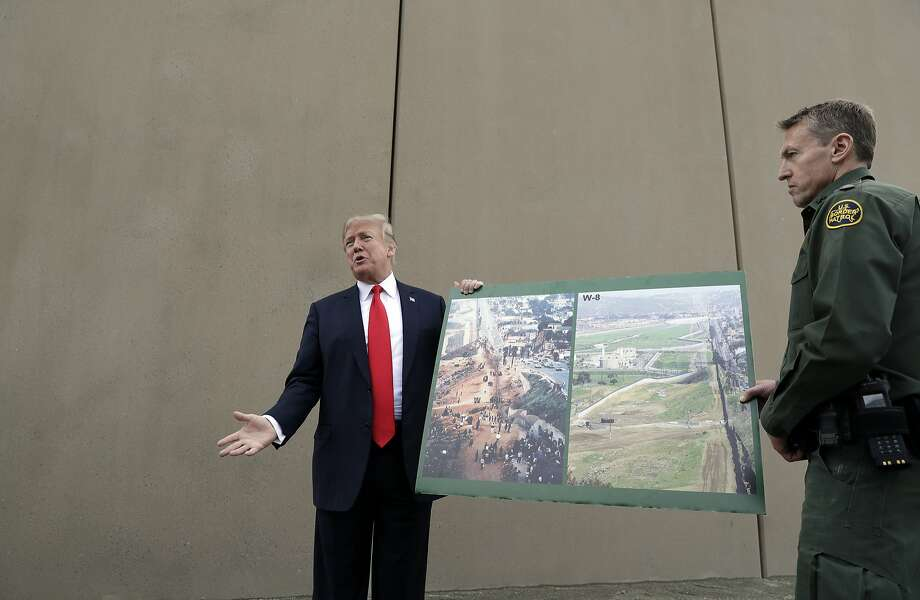 President Donald Trump speaks during a tour as he reviews border wall prototypes, Tuesday, March 13, 2018, in San Diego, as Rodney Scott, the Border Patrol's San Diego sector chief, listens. (AP Photo/Evan Vucci) Photo: Evan Vucci, Associated Press