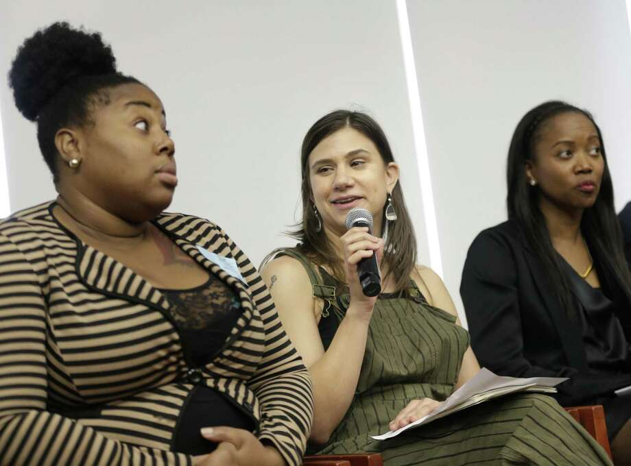 In this Feb. 20, 2018, photo, Gemma Rossi, center, recounts some of the indignities working for tips at a restaurant during a discussion about subminimum wage workers in New York. Advocates for restaurant workers want to do away with the below-minimum wage for tipped workers, saying it forces them to tolerate harassment if they want to be paid. Photo: Seth Wenig /Associated Press / AP
