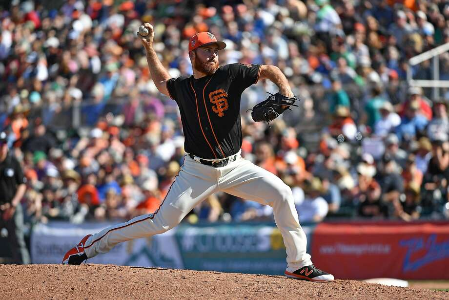 Sam Dyson, shown in Friday's game against the Mariners, converted 14 of 15 saves for the Giants last year before blowing two in the final week of the season. Photo: Jennifer Stewart, Getty Images