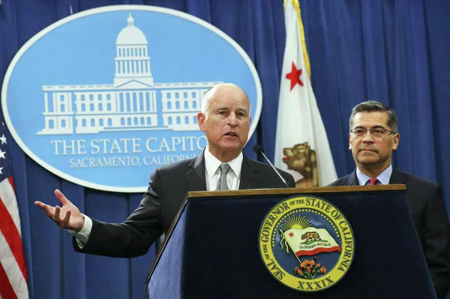 Calif. Gov. Jerry Brown (left), with Xavier Becerra, the state's attorney general, reacts to Attorney General Jeff Sessions' immigration lawsuit announcement last week. Claiming that  liberal politicians were endangering citizens and obstructing federal law, Sessions announced the Trump administration was suing the state over its so-called sanctuary laws. Sessions is hardly the right person to defend the supremacy of the federal government. Photo: JIM WILSON /NYT / NYTNS