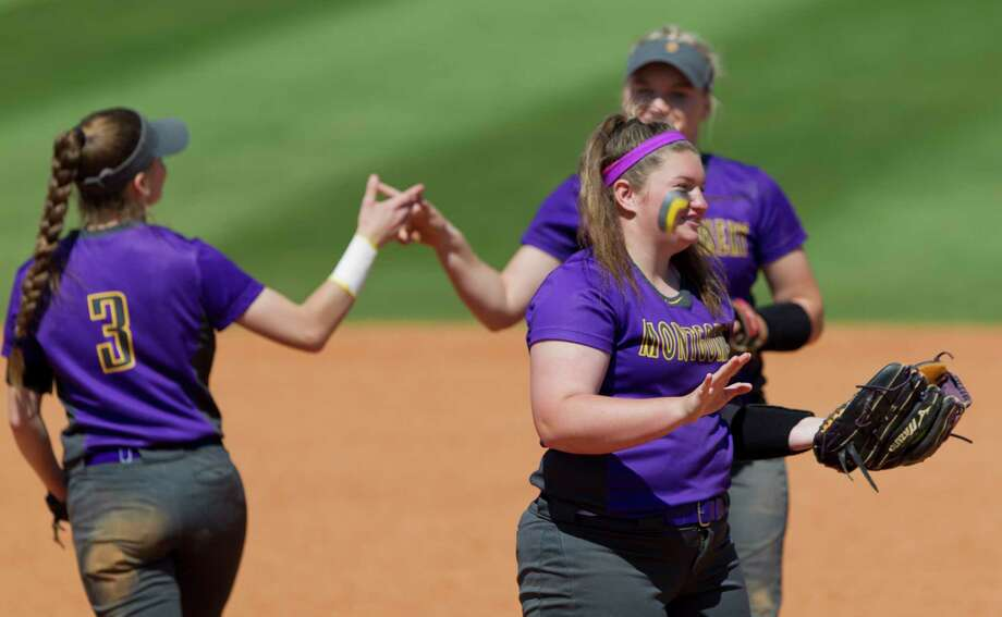 Montgomery starting pitcher Hailey Paker (15) jokes with first baseman Alexa VonGontard before the start of  the second inning of a non-district high school softball game, Tuesday, March 13, 2018, in Montgomery. Photo: Jason Fochtman, Staff Photographer / © 2018 Houston Chronicle