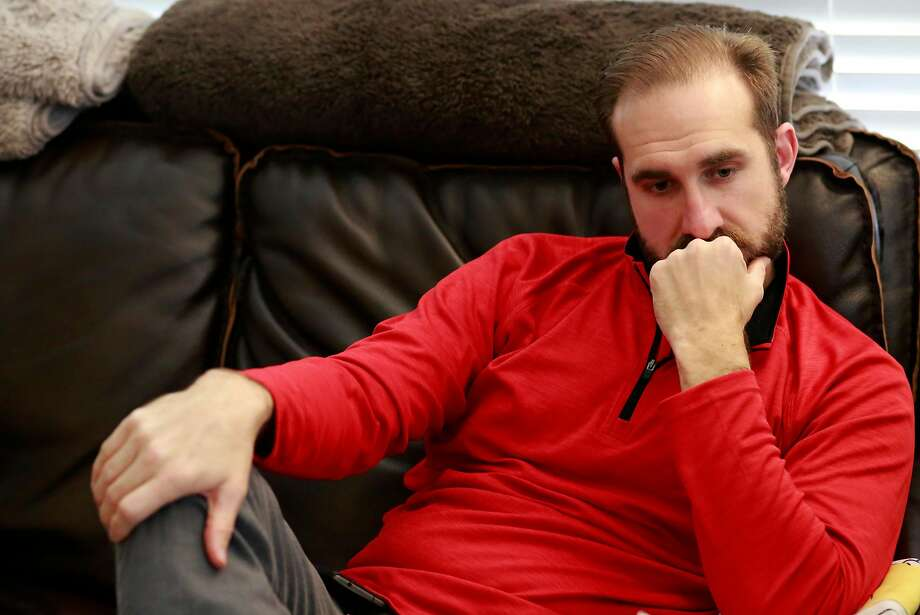 "T.J. Shushereba sits on the couch they named ""Walter,"" while talking about his wife Jennifer Gonzales, at their home in Napa. Gonzales, a clinical psychologist, was was one of three women killed by a gunman who took hostages at the Pathway Home in Yountville. Photo: Michael Macor, The Chronicle"