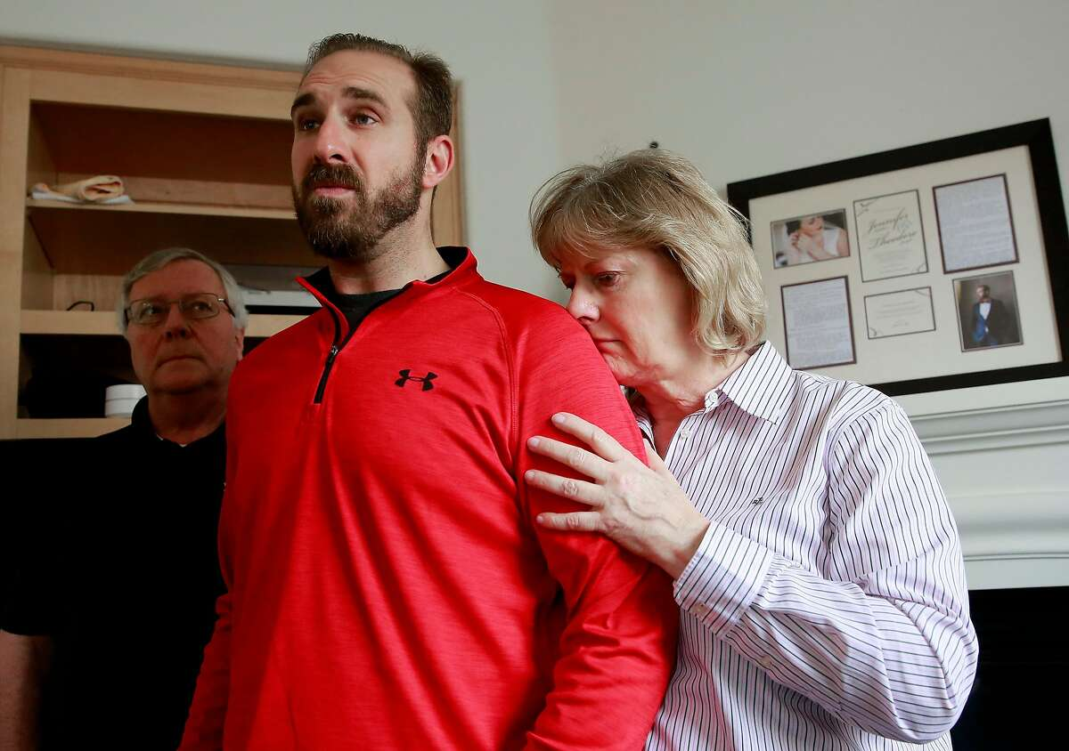 T.J. Shushereba,center, with his parents Ted, left, and Debbietalks about his wife Jennifer Gonzales at their home in Napa. Gonzales was was killed by a gunman inside the Yountville Pathways home, where she worked as a psychologist, last Friday.