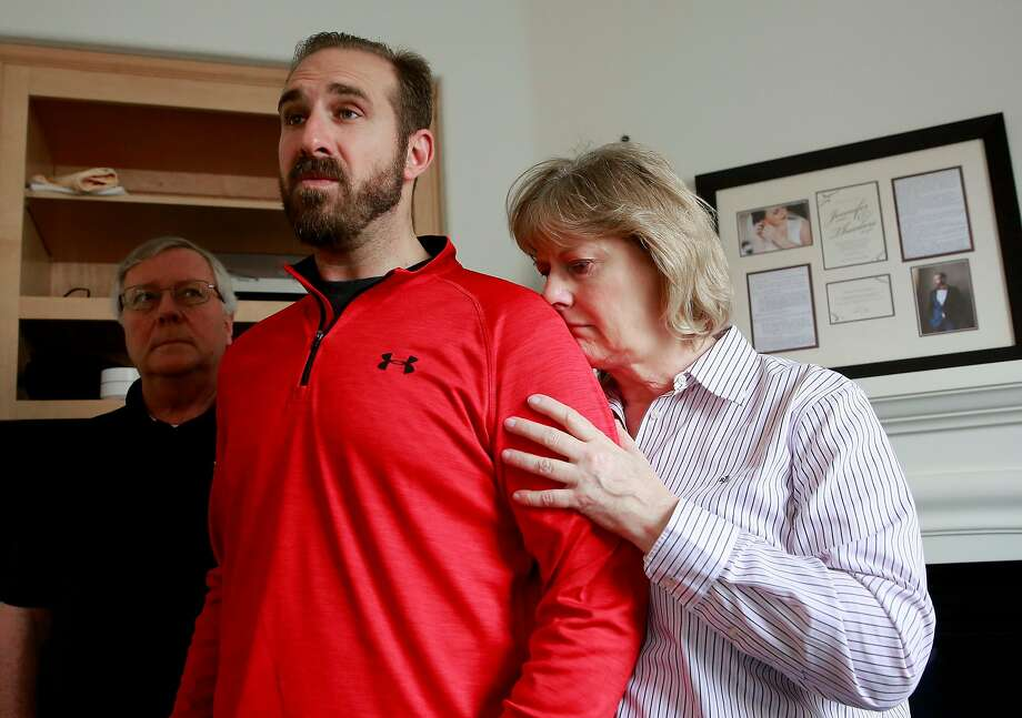 T.J. Shushereba, center, with his parents Ted, left, and Debbie talks about his wife Jennifer Gonzales at their home in Napa. Gonzales was was killed by a gunman inside the Yountville Pathways home, where she worked as a psychologist, last Friday. Photo: Michael Macor, The Chronicle