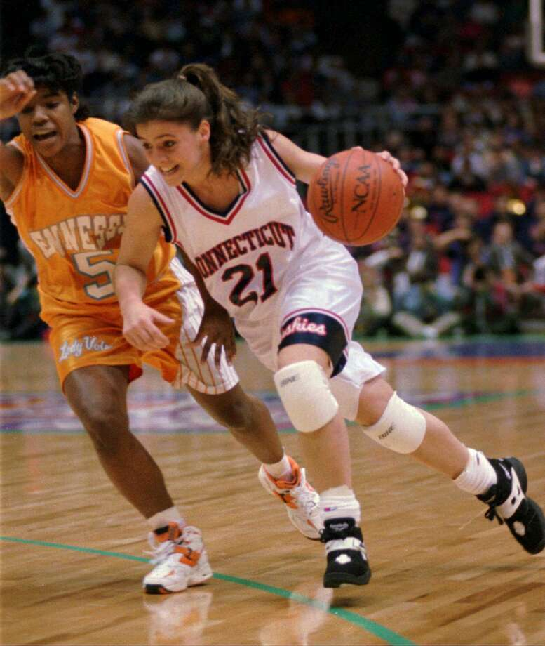 Former UConn guard Jennifer Rizzotti (21) drives past Tennessee guard Latina Davis in the first quarter of the NCAA women's championship game in Minneapolis on April 2, 1995. Photo: BOB CHILD / Associated Press / AP