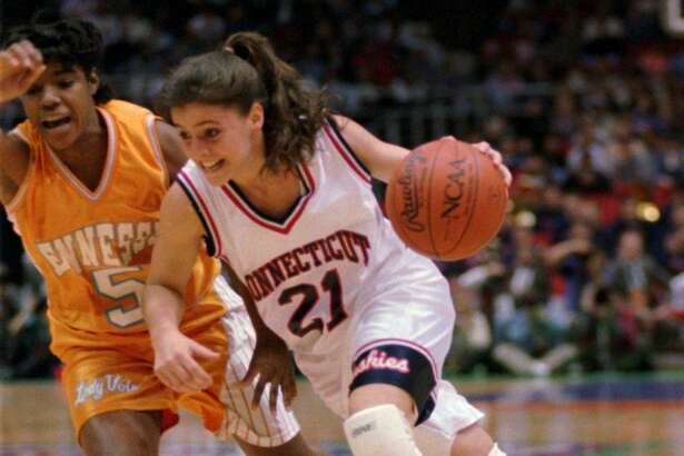 Former UConn guard Jennifer Rizzotti (21) drives past Tennessee guard Latina Davis in the first quarter of the NCAA women's championship game in Minneapolis on April 2, 1995.