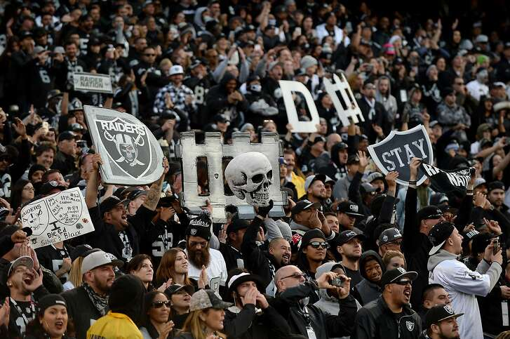 Oakland Raiders fans in The Black Hole celebrate the team's play against the Carolina Panthers on November 27, 2016, at the Coliseum in Oakland, Calif. (Jeff Siner/Charlotte Observer/TNS)
