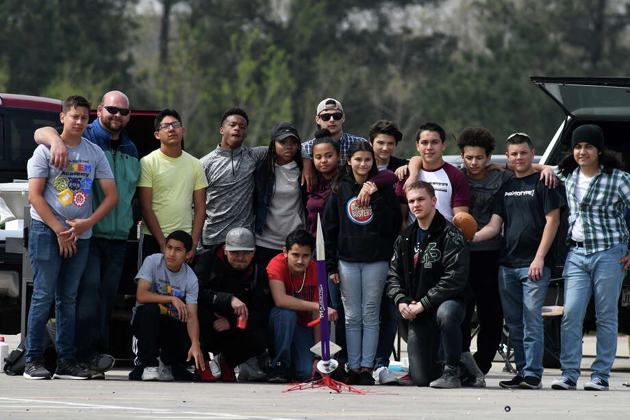 Humble High School STEM students, under the direction of Humble ISD Career and Technology Education Instructor Joe Paneitz, back row second from left, pose for a class photo during round two of their class rocket launching competition in the Turner Stadium parking lot at Humble High School on March 8, 2018. (Photo by Jerry Baker/Freelance) Photo: Jerry Baker, Freelance / Freelance