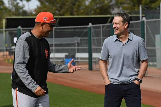Scottsdale, AZ - March 8: David Bell of the San Francisco Giants laughs with manager of Dominican Summer League Giants Jose Montilla at the Giants minor-league complex on March 8, 2018 in Scottsdale, Arizona.
