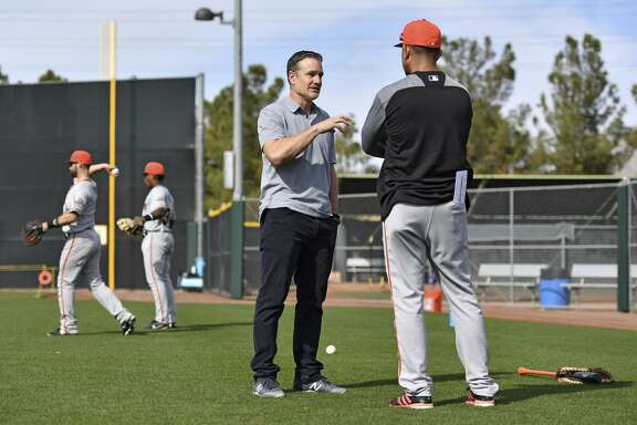 Scottsdale, AZ - March 8: David Bell of the San Francisco Giants talks with manager of Dominican Summer League Giants Jose Montilla at the Giants minor-league complex on March 8, 2018 in Scottsdale, Arizona.