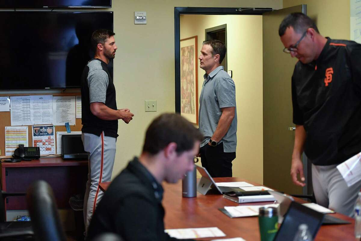 Scottsdale, AZ - March 8: David Bell of the San Francisco Giants talks with assistant director player development - run prevention Matt Buschmann during a meeting at the Giants minor-league complex on March 8, 2018 in Scottsdale, Arizona.