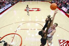 Michael Humphrey of Stanford Men's Basketball shoots over a USC defender during a Pac-12 NCAA basketball game at Maples Pavilion in Stanford on January 7, 2018.