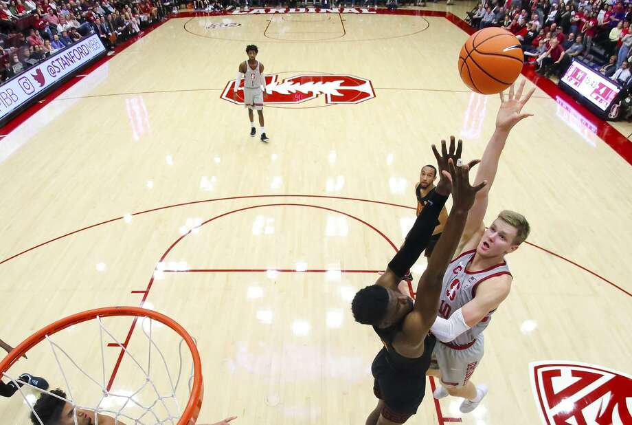 Michael Humphrey of Stanford Men's Basketball shoots over a USC defender during a Pac-12 NCAA basketball game at Maples Pavilion in Stanford on January 7, 2018. Photo: Bob Drebin / Bob Drebin / Isiphotos.com / Bob Drebin / isiphotos.com