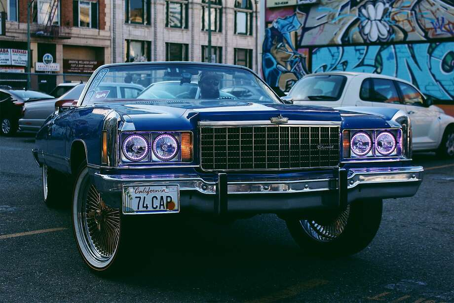 The museum exhibition, described as a living history show on hip-hop, has cultural references as well as musical ones, including Amanda Sade's image of DropReg, president of the East Bay Chevs group, in his ride at an Oakland video shoot. Photo: Oakland Museum Of California