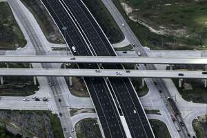 Cars travel along the Grand Parkway as it crosses atop Texas 249 southeast of Tomball on April 14, 2017.