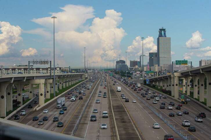 Lanes of Interstate 10, with the Katy Managed Lanes in the center, stretch out looking east toward downtown from the entrance ramp to the southbound Sam Houston Tollway on July 19, 2017.