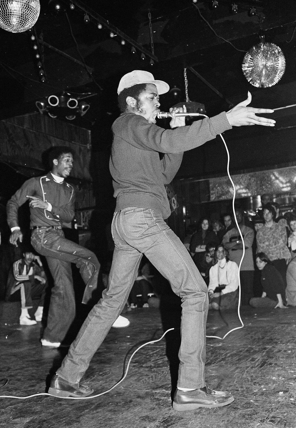 """Oakland Museum of California presents """"Respect: Hip-Hop Style & Wisdom,"""" Joe Conzo, JDL (Jerry D. Lewis) of Cold Crush Brothers at Club Negril, 1981. Photo print. Courtesy of the Joe Conzo Archives."""