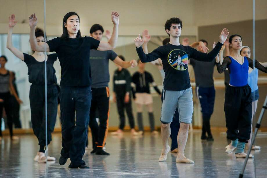 Choreographer Edwaard Liang (left front) directs his dancers during a rehearsal session for Unbound: A Festival of New Works. Photo: Nicole Boliaux / The Chronicle