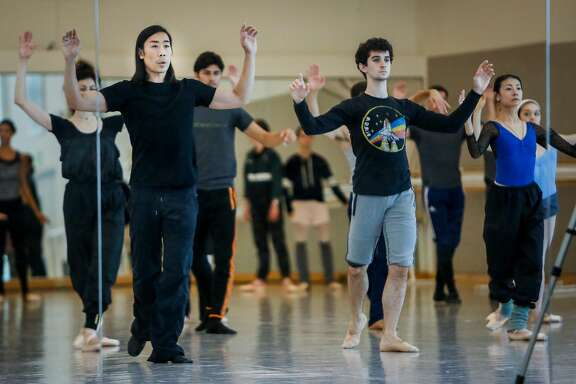 Choreographer Edwaard Liang, left front, directs his dancers during a rehearsal session for Unbound: A Festival of New Works at the San Francisco Ballet in San Francisco on Thursday, July 19, 2017.