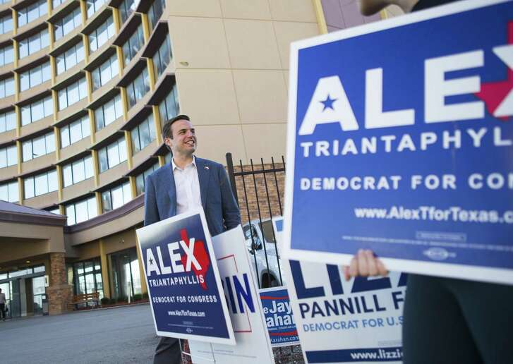 Democratic 7th Congressional District candidate Alex Triantaphyllis waits for potential voters outside a polling location at the Four Points by Sheraton hotel in Houston on the Southwest Freeway on Tuesday, March 6, 2018.