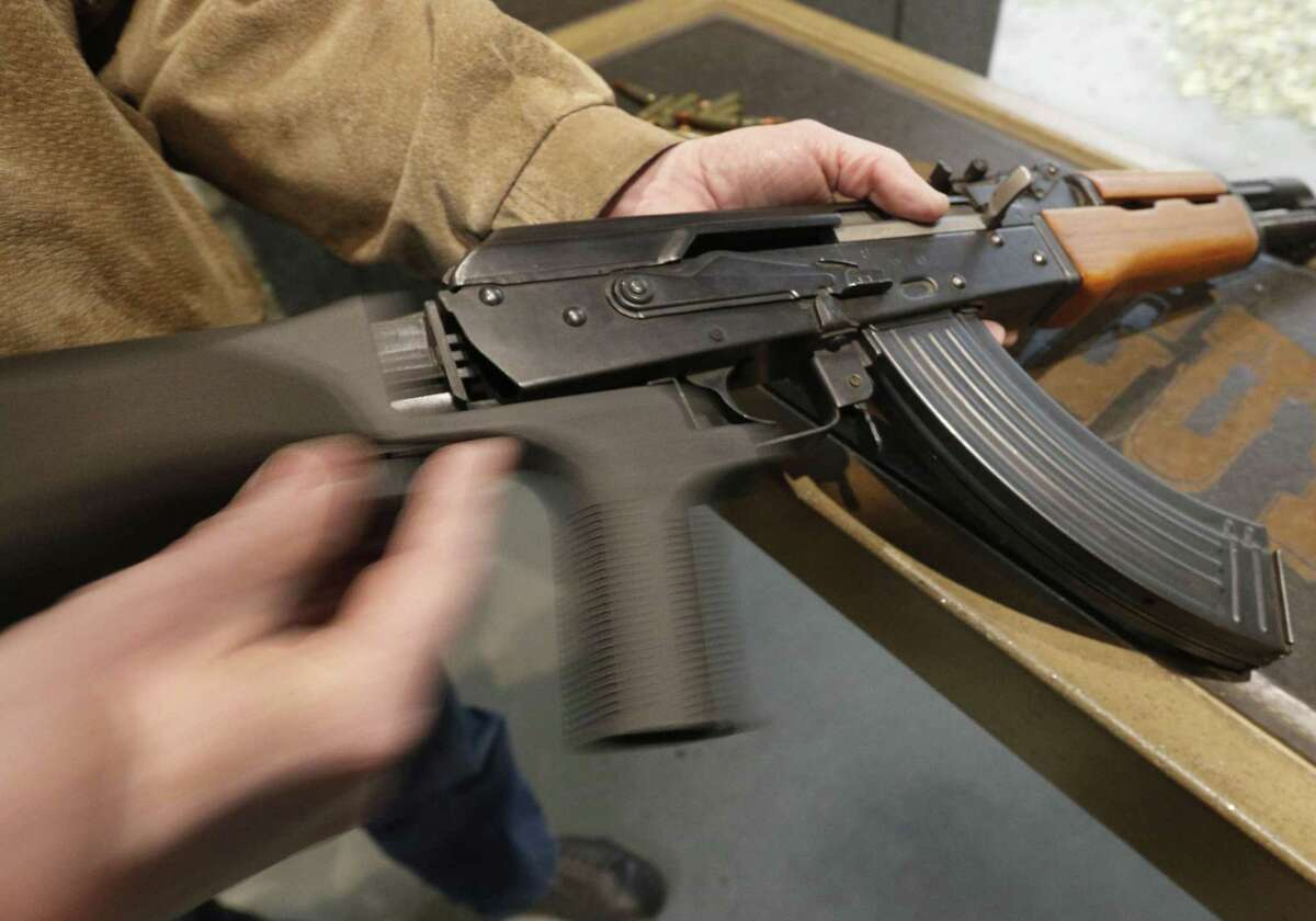 A bump stock is installed on an AK-47 and its movement is demonstrated at Good Guys Gun and Range in Orem, Utah. The bump stock is a device when installed allows a semi-automatic to fire at a rapid rate much like a fully automatic gun.