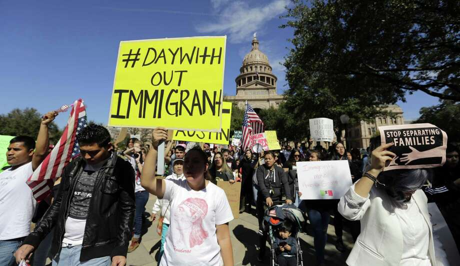 A group marches away from the Texas Capitol during an immigration protest, Thursday, Feb. 16, 2017, in Austin, Texas.Immigrants around the U.S. stayed home from work and school Thursday to demonstrate how important they are to America's economy and its way of life, and many businesses closed in solidarity, in a nationwide protest called A Day Without Immigrants.  (AP Photo/Eric Gay) Photo: Eric Gay, STF / Associated Press / Internal