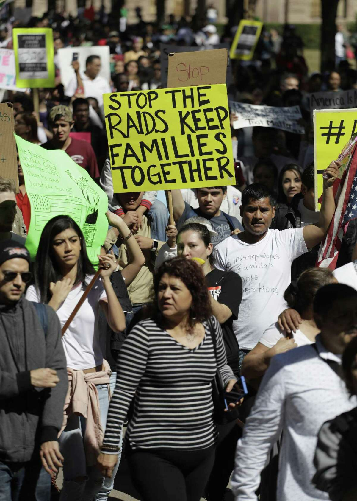 A group marches away from the Texas Capitol during an immigration protest, Thursday, Feb. 16, 2017, in Austin, Texas. Immigrants around the U.S. stayed home from work and school Thursday to demonstrate how important they are to America's economy and way of life, and many businesses closed in solidarity, in a nationwide protest called A Day Without Immigrants.(AP Photo/Eric Gay)
