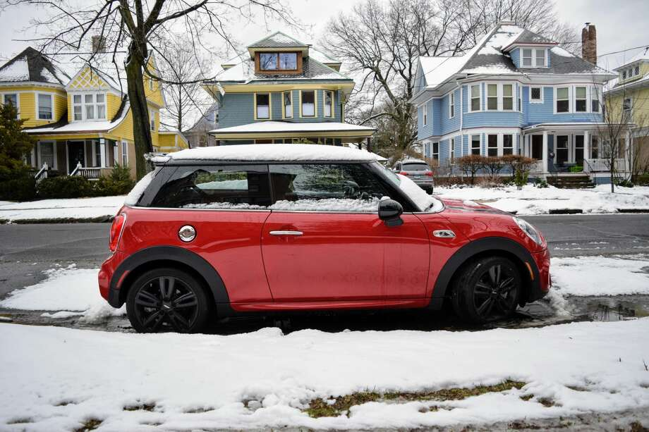 A Mini Cooper sits in snow on March 13, 2018. Photo: Derek Turner / Hearst Connecticut Media