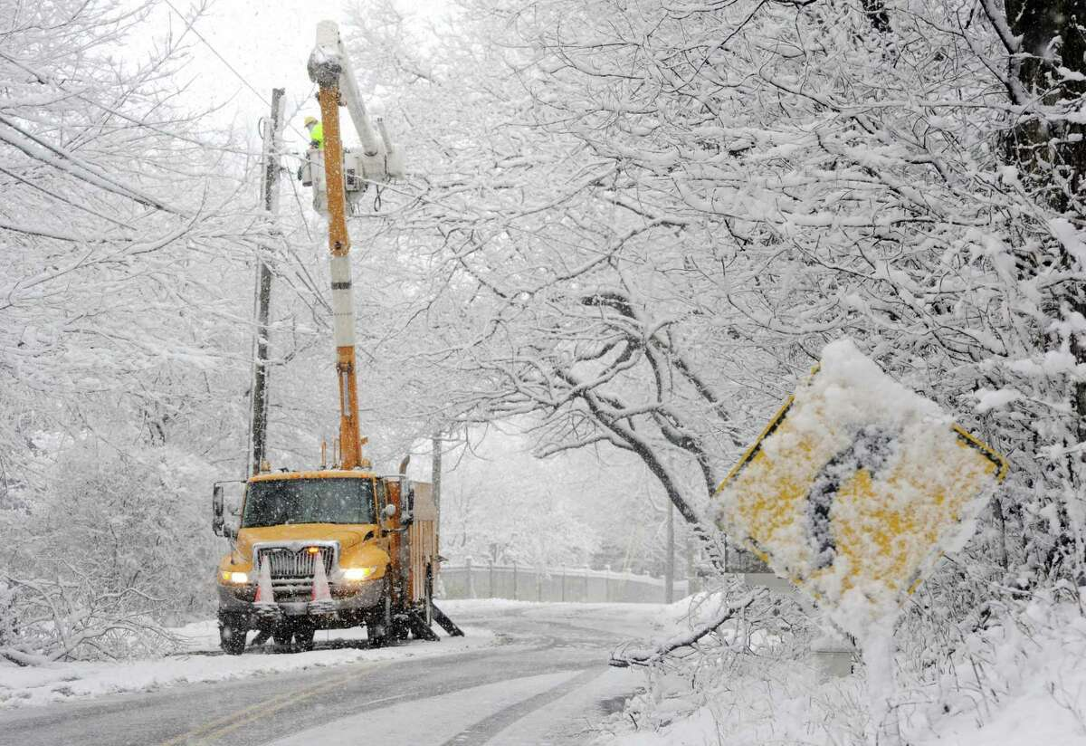 A UI crew works to restore power to homes on Hill Farm Road in Fairfield, Conn., after they lost power on Tuesday, March 13, 2018. After the region wrapped up recovery from last Wednesday's treacherous snowstorm that left about 160,000 in Connecticut in the dark, the third storm in less than two weeks hit New England on Tuesday, leaving some areas of Connecticut with nearly 11 inches of snow and others with barely a dusting. Fairfield County totals ranged between just under an inch along the coast to 10.8 inches in Newtown, the National Weather Service reported. In New Haven County, totals started around less than half an inch in New Haven and were highest in Seymour at 4.5 inches. New Jersey snowfall accumulations were between less than half an inch and 3.5 inches. In New York, Nassau County saw between 1.6 to 6.5 inches, Orange County had between 3.3 and 5.5 inches and Westchester got between 3.1 and 5.2 inches. Boston reported 8.5 inches of snow, but several parts of Massachusetts received more than a foot. State police reported, between 4 a.m. and 4 p.m., troopers responded to 810 calls for service, 170 motorist assists, 75 accidents without injuries, two accidents with injuries and zero fatalities.