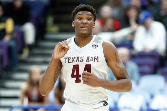 Texas A&M's Robert Williams runs down the court against the Alabama Crimson Tide during the second round of the 2018 SEC Basketball Tournament at Scottrade Center on March 8, 2018 in St Louis, Missouri.