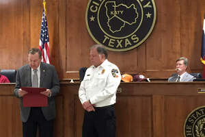 Katy Mayor Chuck Brawner reads a proclamation honoring Katy Fire Chief Russell Wilson  after he was named Texas Fire Chief of the Year by the Texas Fire Chiefs Association.