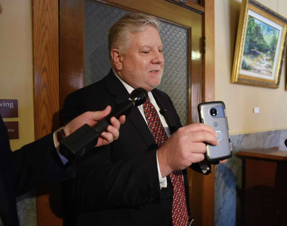 Ted Davis, CEO of Utility, a company that manufactures cameras for law-enforcement use, explains how the field-of-view can be changed on a body-worn camera on Tuesday, March 13, 2018. Photo: Billy Calzada, Staff / San Antonio Express-News / San Antonio Express-News