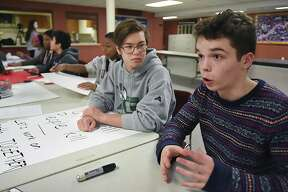 Tyler Felson, 17, at right, and Brendan O'Callahan, 18, students at Guilford High School invited schoolmates to make protest signs, Tuesday night, March 13, 2018, at First Congregational Church at 122 Broad Street in Guilford. The posters will be used for the planned walkout on Wednesday to show support for the students at Marjory Stoneman Douglas High School in Parkland, Fla. and protest gun violence.