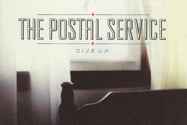 """Postal Service -- Give Up  Ben Gibbard was already established as an indie-rock dreamboat thanks to his work fronting Death Cab For Cutie, but his 2003 collaboration with electronic musician Jimmy Tamborello (plus cameos from Rilo Kiley's Jenny Lewis) leant Gibbard's heartfelt lyrics and boyish voice to a whole new genre. """"Such Great Heights"""" is a classic, but our pick for best track is the dark opener """"The District Sleeps Alone Tonight."""""""