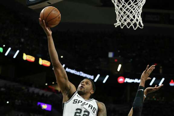 Spurs' Rudy Gay (22) lays up a shot against Orlando Magic's Wesley Iwundu (25) during their game at the AT&T Center on Tuesday, Mar. 13, 2018.