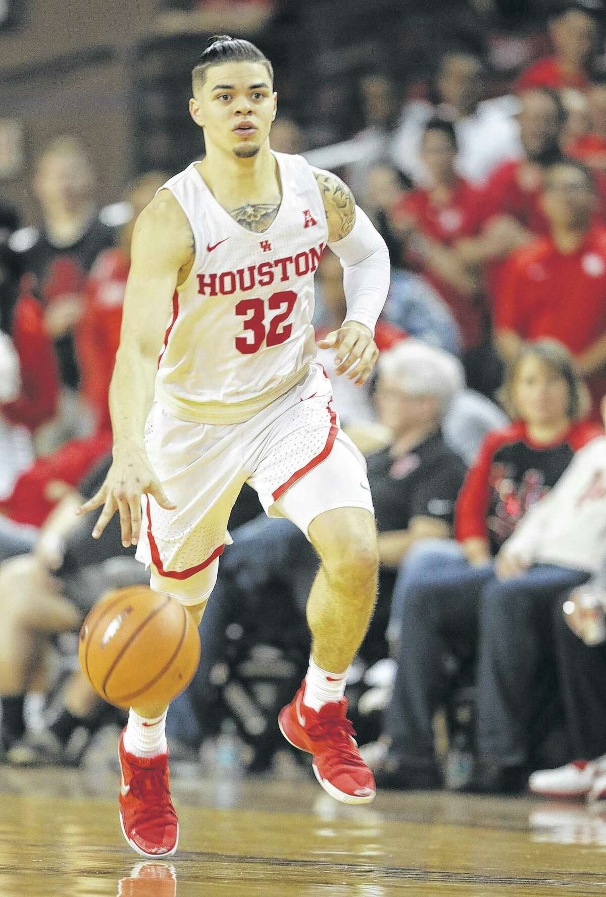 Houston Cougars guard Rob Gray (32) dribbles across the court against Connecticut Huskies at H&PE Arena at TSU on Sunday, March 4, 2018, in Houston. Houston Cougars won the game 81-71. ( Elizabeth Conley / Houston Chronicle )