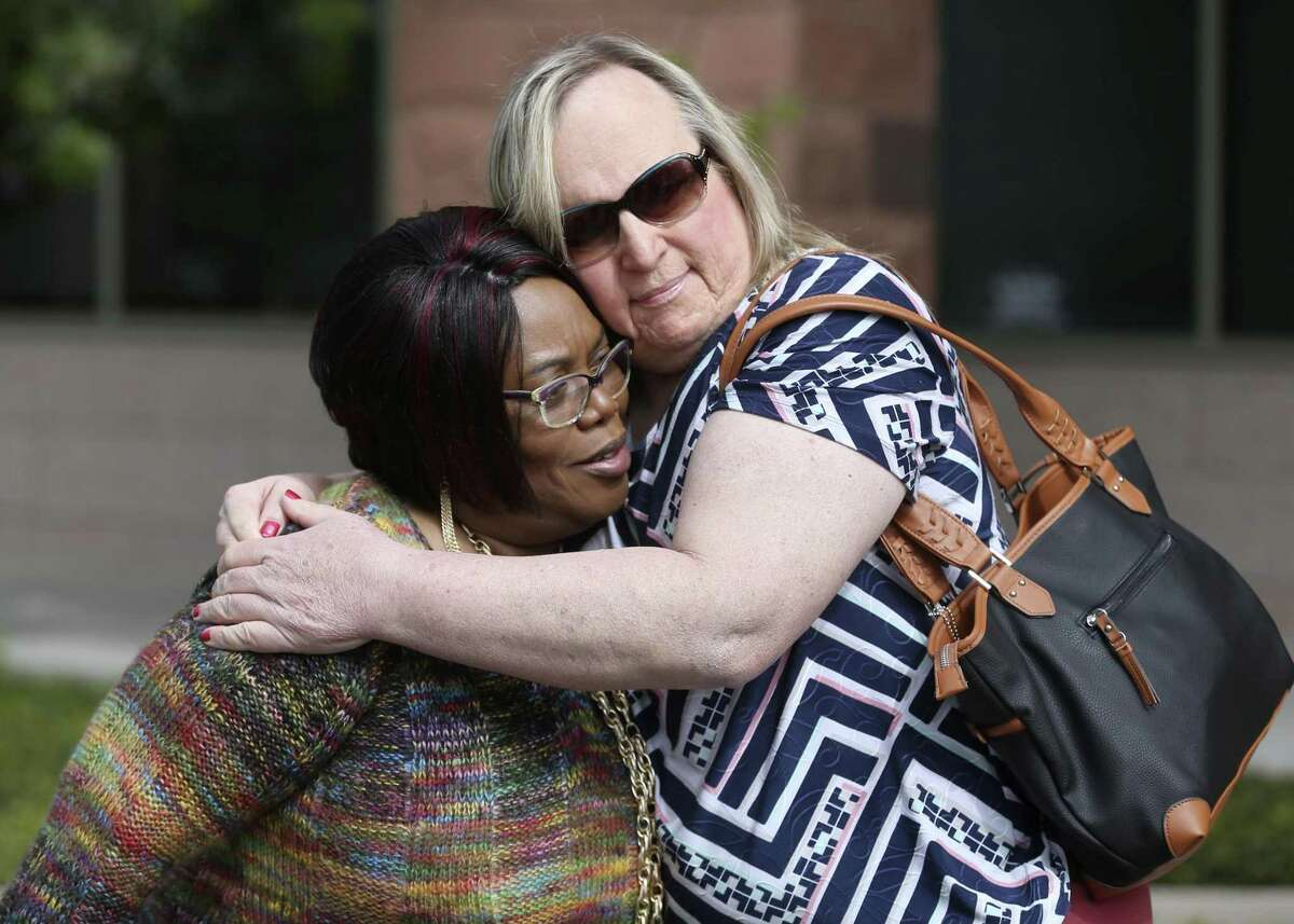 Joann McFadden, left, is hugged Tuesday, March 13, 2018 outside the Bexar County Criminal Justice Center by Lauryn Farris before a news conference by LGBTQ community members to denounce the handling of Kenne McFadden's case by the District Attorney's office. McFadden is the mother of Kenne McFadden, a transgender woman who was allegedly killed by Mark Lewis. Lewis can not be prosecuted for the alleged crime after prosecutors failed to convince a judge the incident was grounds to revoke Lewis's parole.