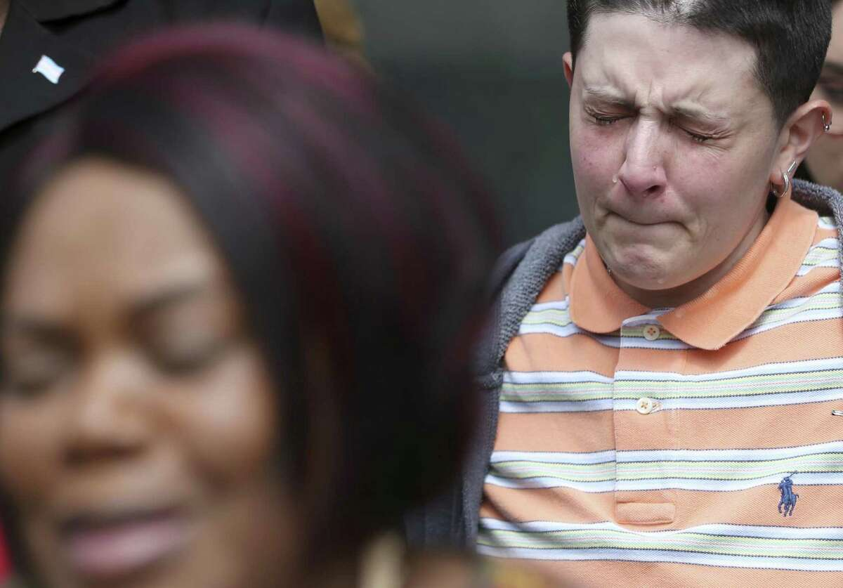Tears roll down Andrea Bonilla's cheek while listening to Joann McFadden say a prayer of forgiveness Tuesday, March 13, 2018 outside the Bexar County Criminal Justice Center. McFadden is the mother of Kenne McFadden, a transgender woman who was allegedly killed by Mark Lewis. Lewis can not be prosecuted for the alleged crime after prosecutors failed to convince a judge the incident was grounds to revoke Lewis's parole.