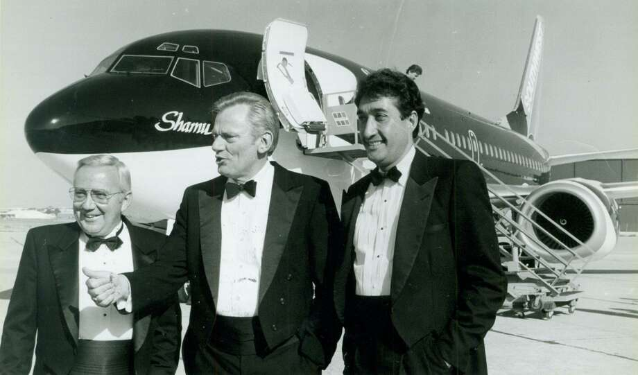 George Becker, CEO of Sea World; Herb Kelleher, chairman of Southwest Airlines; and Mayor Henry Cisneros, May 23, 1988. Photo: File Photo / Express-News / San Antonio Express-News