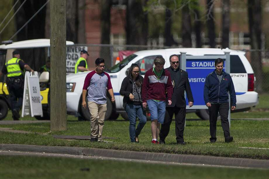 A group of people who said they were on campus to offer support to those effected by the bus crash earlier in the day in Alabama walk down Sheldon Road after coming from Channelview High School, Tuesday, March 13, 2018, in Channelview. Photo: Mark Mulligan / Mark Mulligan / Houston Chronicle / © 2018 Houston Chronicle