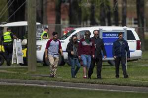 A group of people who said they were on campus to offer support to those effected by the bus crash earlier in the day in Alabama walk down Sheldon Road after coming from Channelview High School, Tuesday, March 13, 2018, in Channelview.